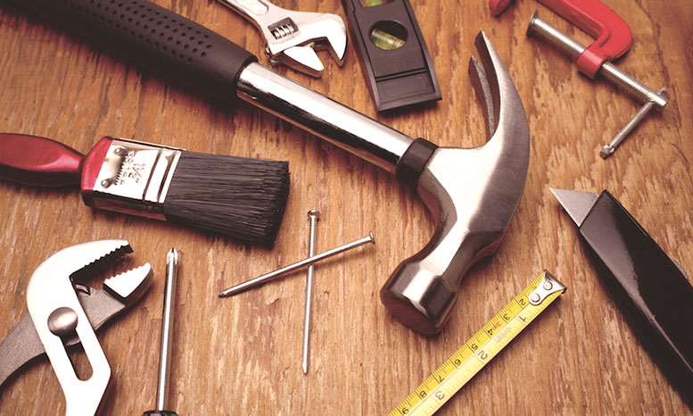 table full of tools for home maintenance
