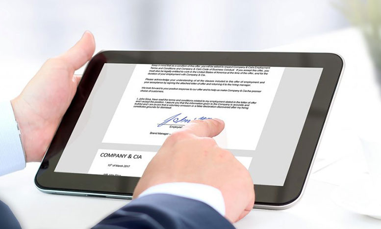 man e-signing on a tablet